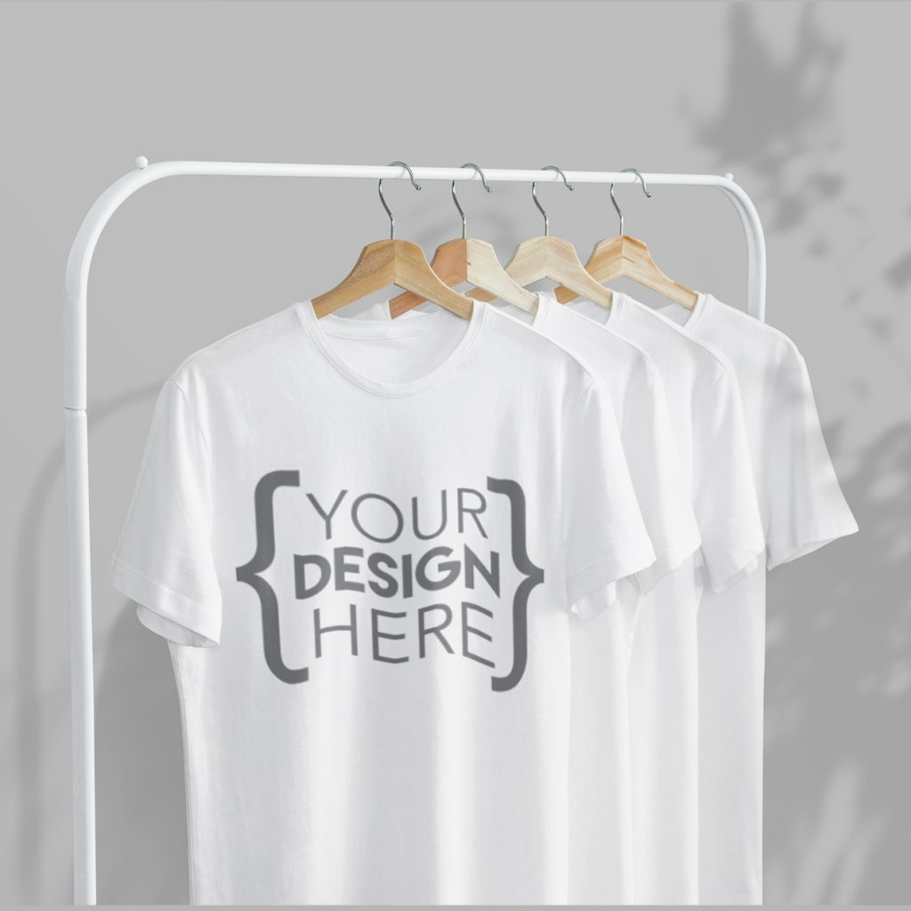 https://www.onestop4printing.com/wp-content/uploads/2020/07/mockup-of-four-t-shirts-hanging-from-a-metal-clothing-rack-3731-el1-2-1024x1024.jpg